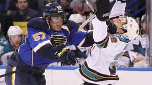 Blues winger David Perron collides with San Jose defenseman Dan Boyle in first period action on Thursday, April 12, 2012, at the Scottrade Center in St. Louis.