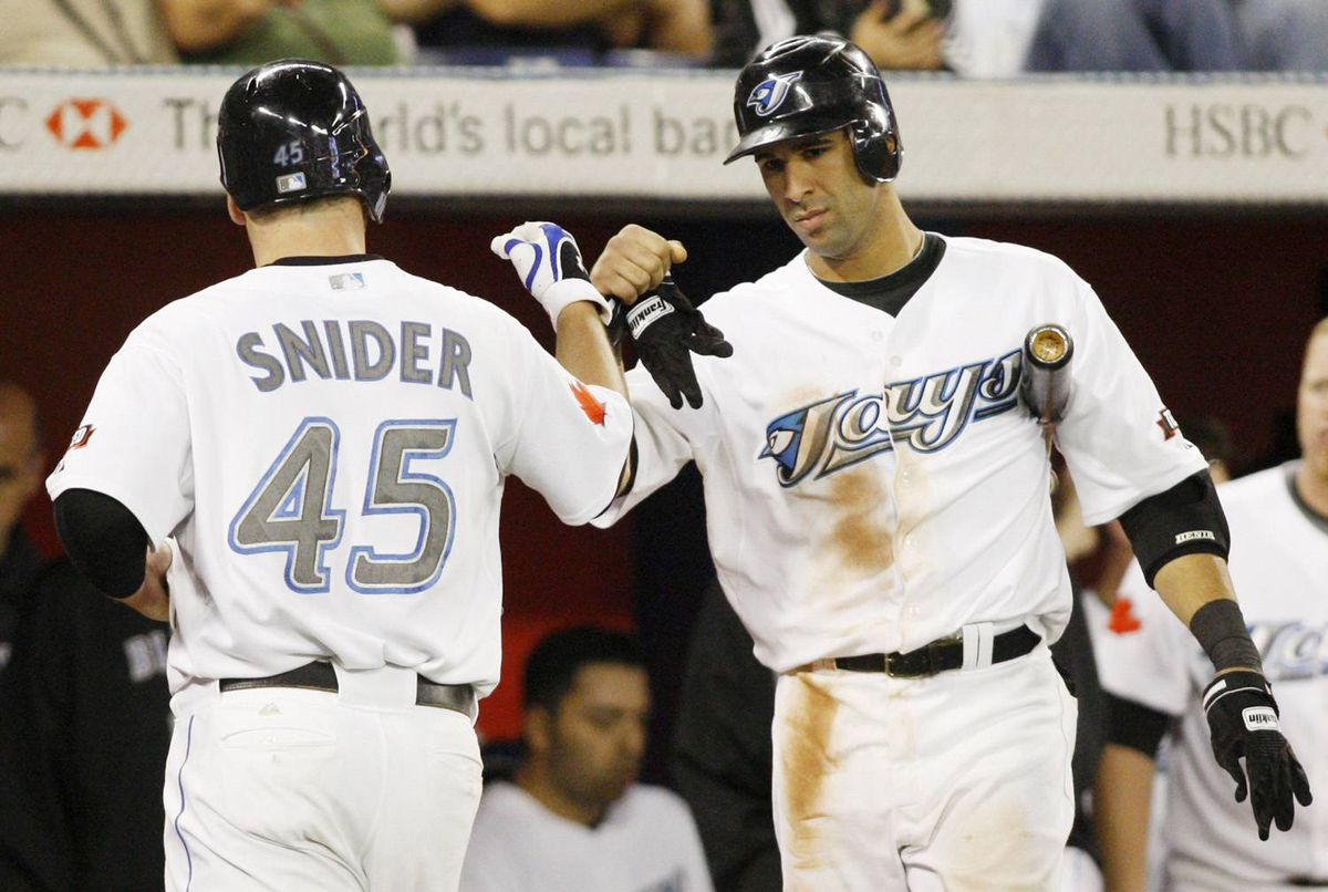 Toronto Blue Jays' Jose Bautista congratulates Travis Snider on his home run against the Baltimore Orioles during the sixth inning of their MLB American League baseball game in Toronto September 23, 2009.