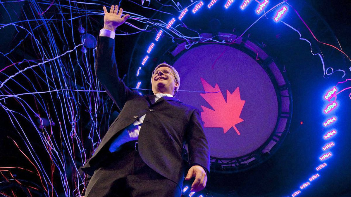 Prime Minister Stephen Harper waves to the crowd following after his election-night victory speech in Calgary on May 2, 2011.