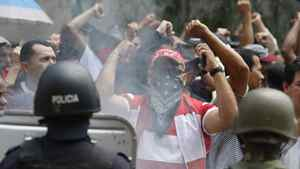 Supporters of Honduras' ousted president Manuel Zelaya yell at soldiers during a march in Tegucigalpa on Tuesday.