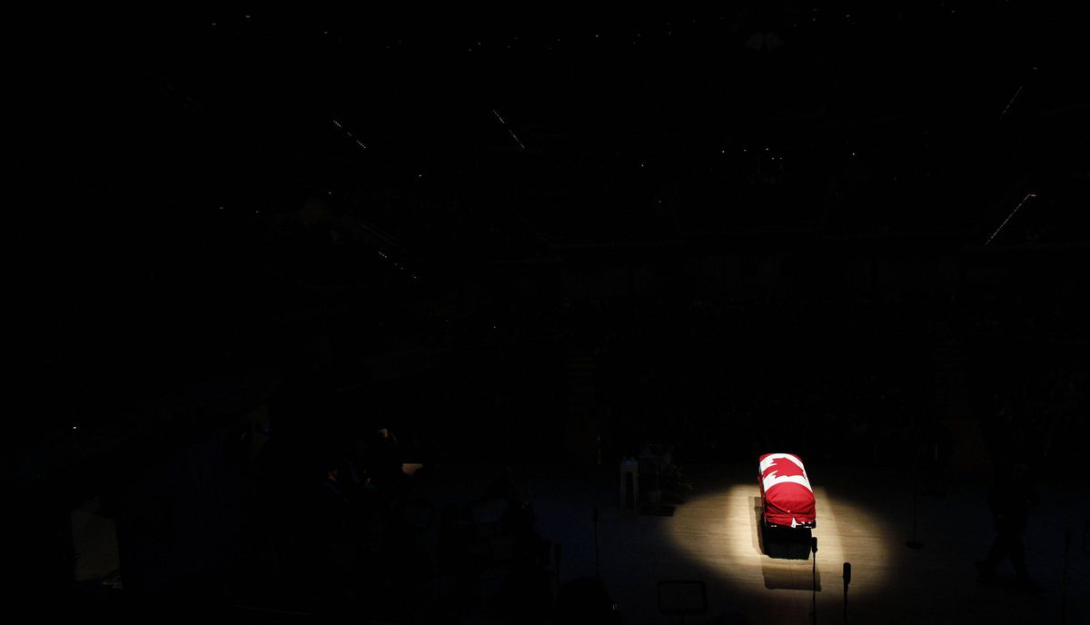 The coffin of the late NDP leader Jack Layton sits under a spotlight during his state funeral at Roy Thomson Hall.
