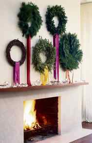 THE LOOK My No. 1 rule is to keep holiday decor real, fresh and restrained. I hung five wreaths made of different natural materials on removable adhesive hooks to make the most of a large space over a fireplace. Draped ribbons, instead of the traditional bow, adds a contemporary touch.