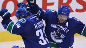 Vancouver Canucks' Henrik Sedin, of Sweden, left, celebrates his goal with Daniel Sedin, of Sweden, during the third period of game 1 of NHL Western Conference final Stanley Cup playoff hockey action in Vancouver, B.C., Sunday, May 15, 2011. THE CANADIAN PRESS/Jonathan Hayward