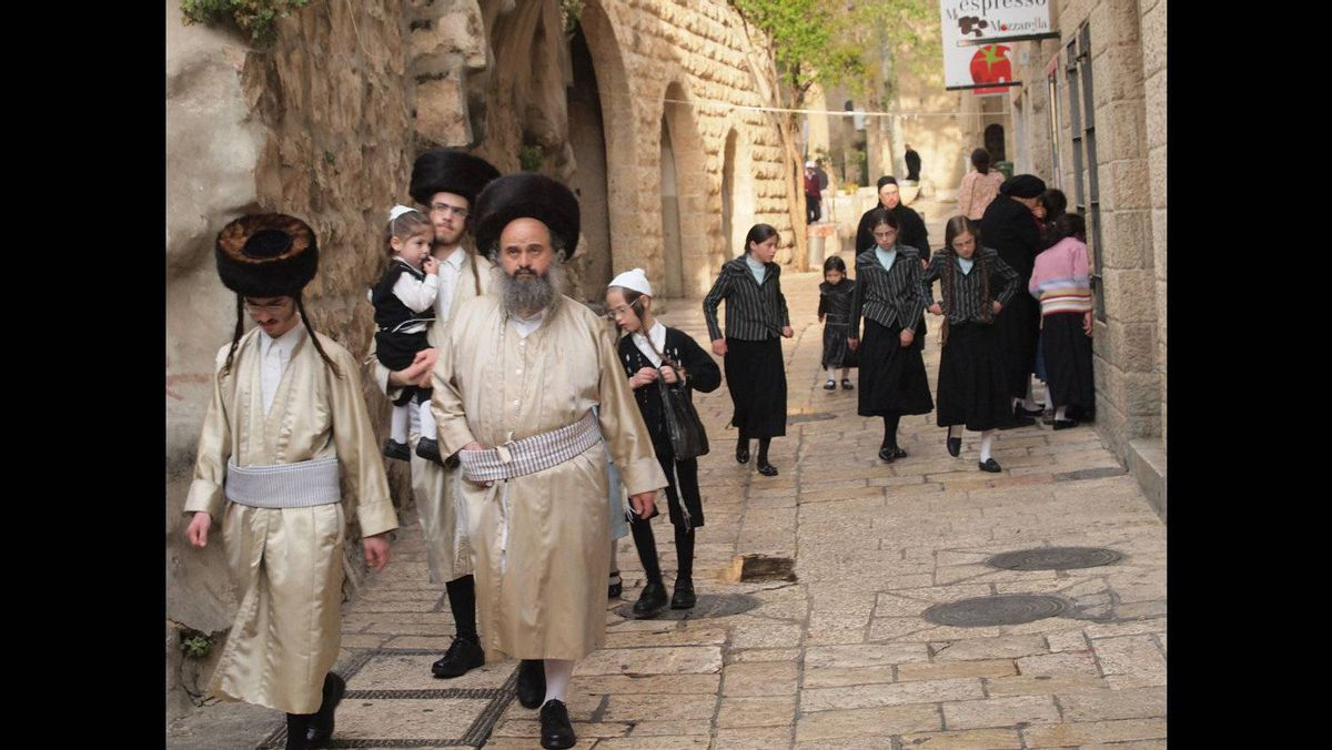 Tzvi Aviv photo: Passover Stroll in the Old City of Jerusalem - A street in the old city of Jerusalem, hasidic family in a Passover holiday stroll.