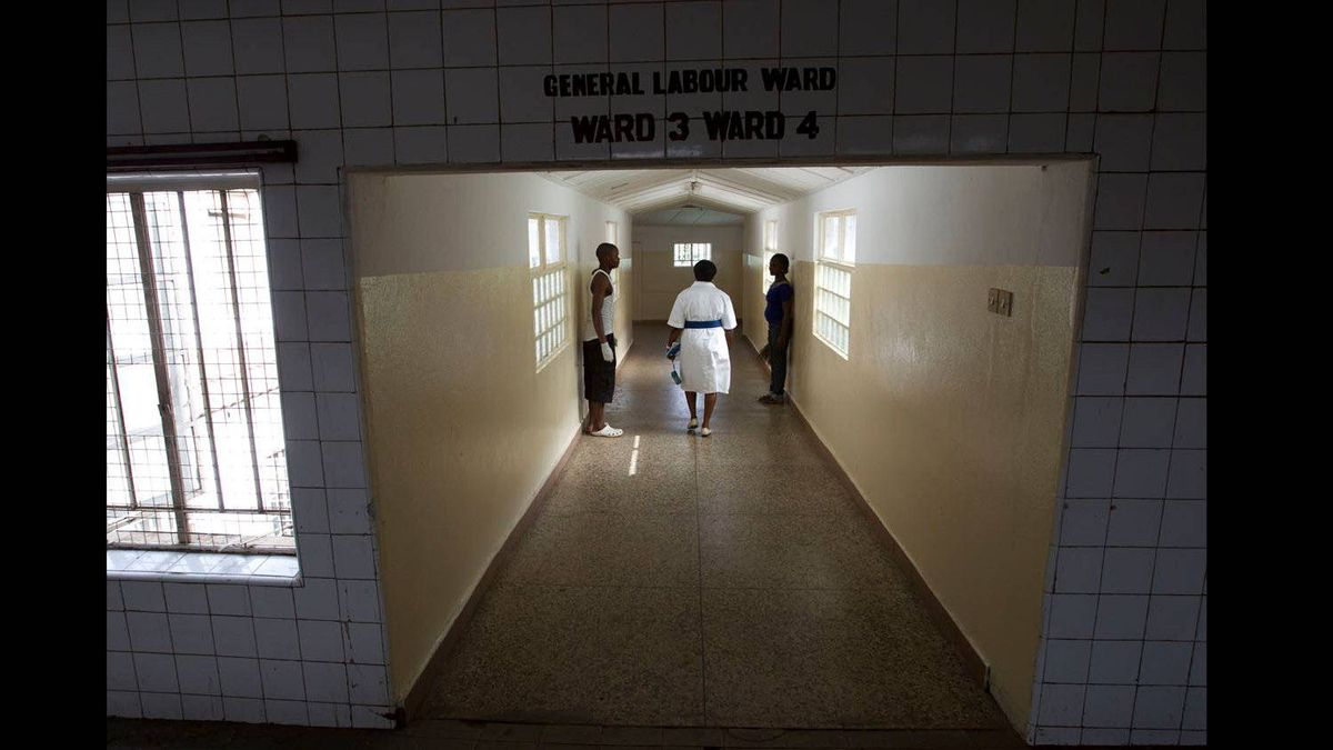 Hospital workers stand aside as the matron of the hospital, Ruby Williams, does her rounds.