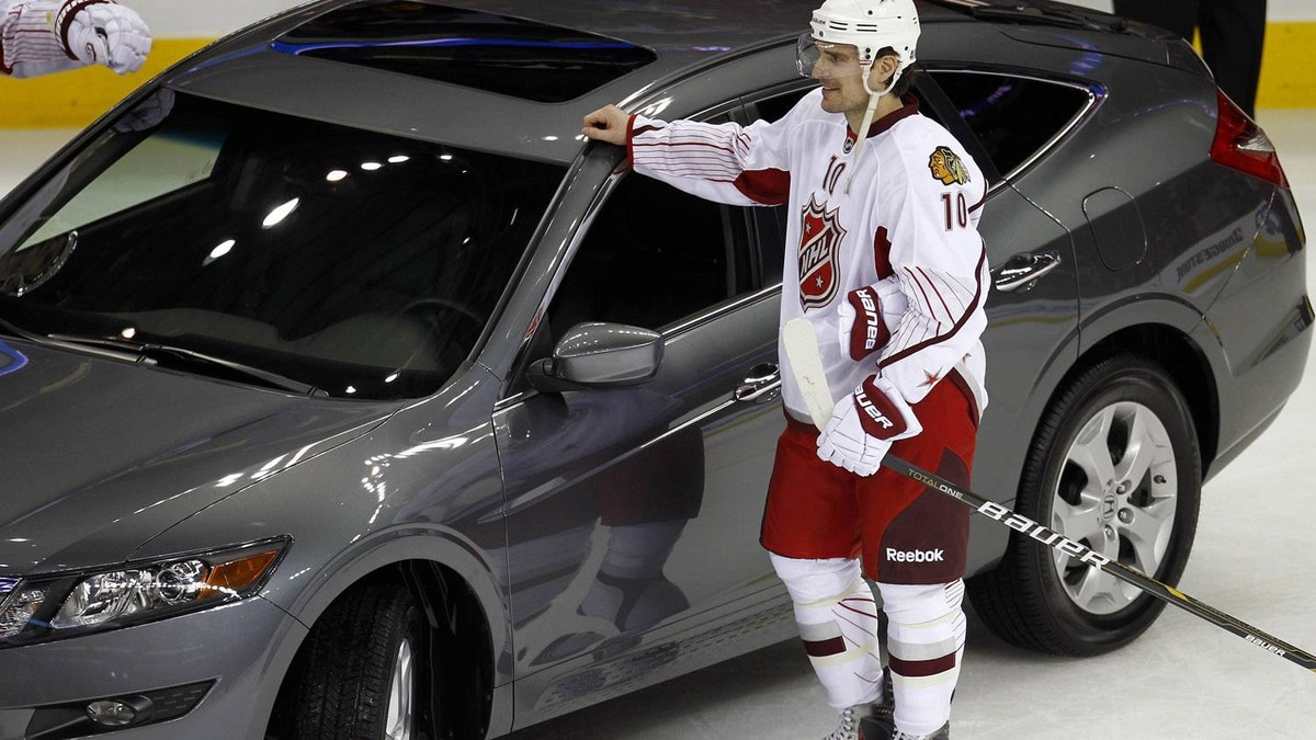Patrick Sharp of team Staal and the Chicago Blachawks stands next to his Honda car, the prize for being named the MVP of the NHL All-Star hockey game in Raleigh, North Carolina, January 30, 2011. REUTERS/Shaun Best