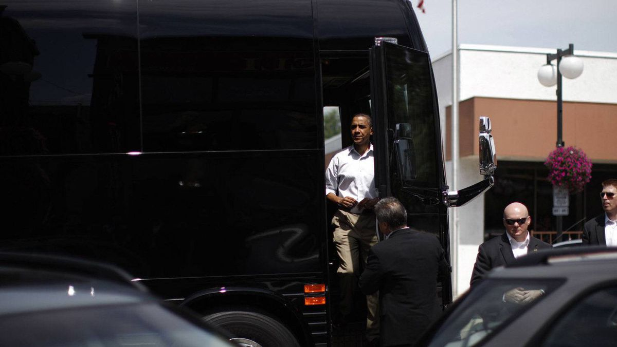 U.S. President Barack Obama steps off his bus to have lunch with five post-9/11 Minnesota veterans at Old Market Deli in Cannon Falls, Minnesota August 15, 2011.