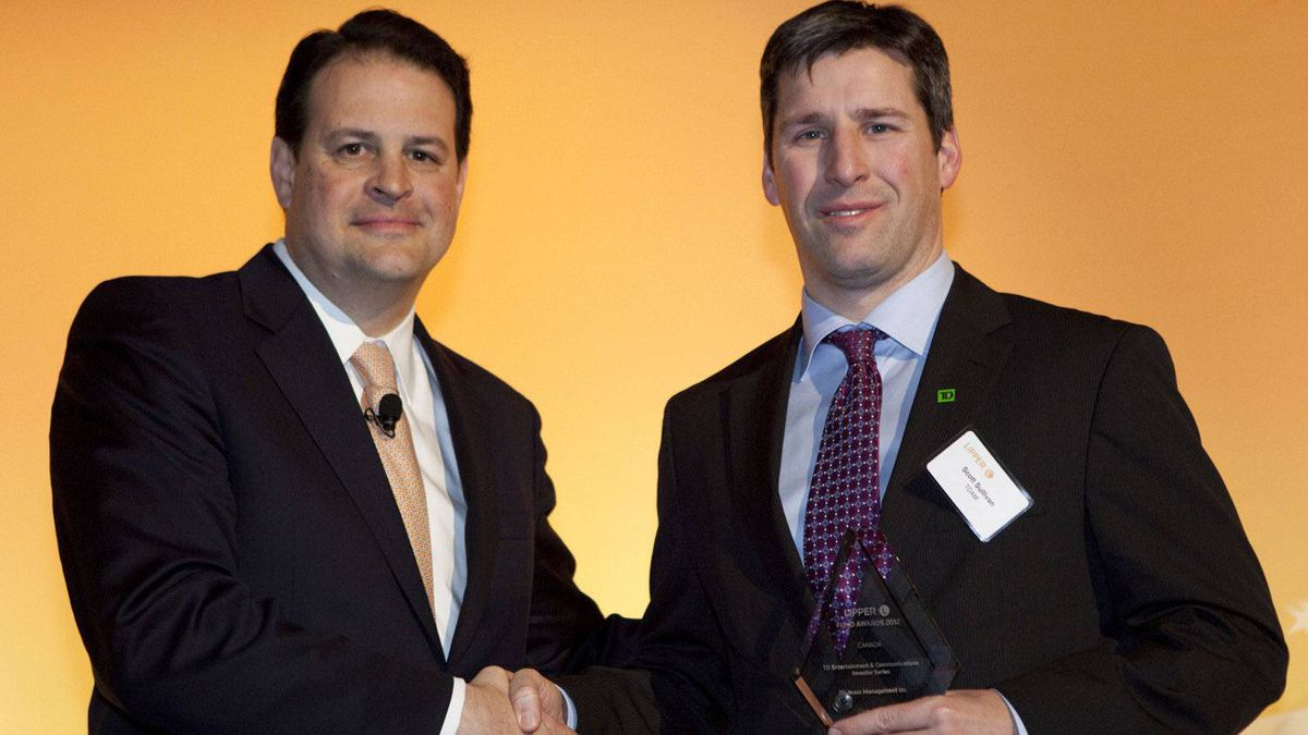 Jim Weber of Thomson Reuters, left, poses with Scott Sullivan, who accepts an award for the TD Entertainment and Communications Investor Series fund.