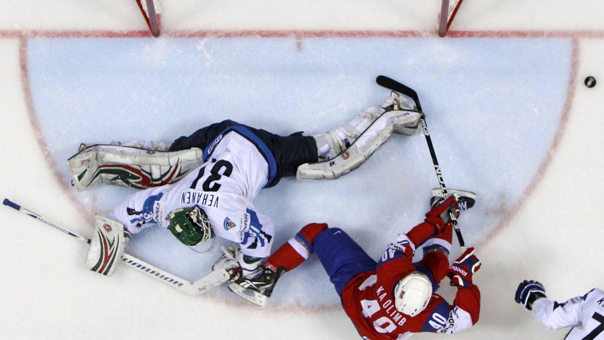Norway's Ken Andre Olimb scores a goal against Finland's goaltender Petri Vehanen during their quarter-final match at the Ice Hockey World Championships in Bratislava.