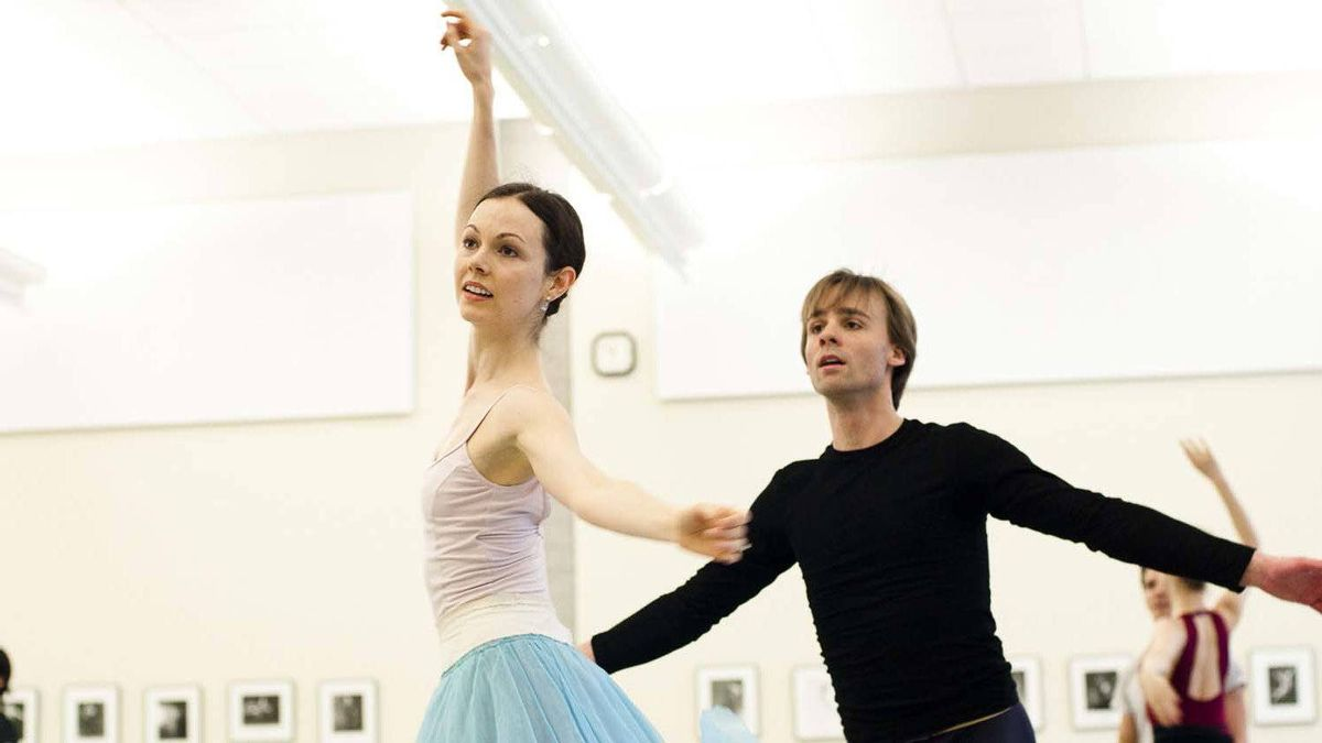 "Jillian Vanstone and Zdenek Konvalina in rehearsal for ""Alice's Adventures in Wonderland"""