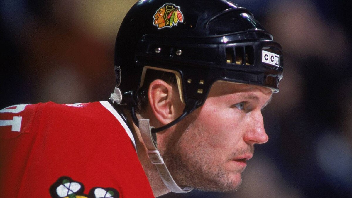 Former NHLer Bob Probert #42 of the Chicago Blackhawks, taken during the NHL game against the Bufallo Sabres at the HSBC Arena in Buffalo, New York. Probert died on July 5, 2010 after collapsing during a boating trip on Lake St. Clair. Rick Stewart /NHLI/Getty Images