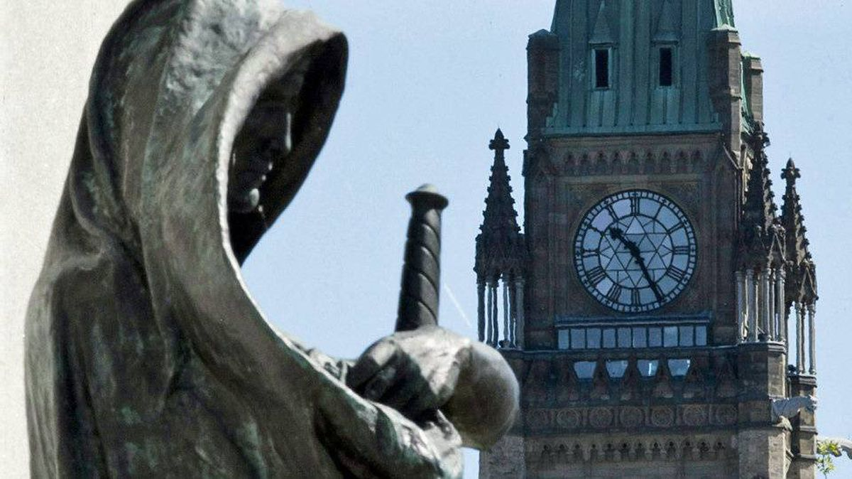 Truth, a statue at the entrance of the Supreme Court of Canada, is seen with the Peace Tower in background in Ottawa on May 7, 2010.