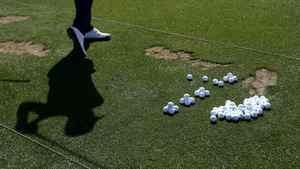 Golfer hitting golf balls on the range