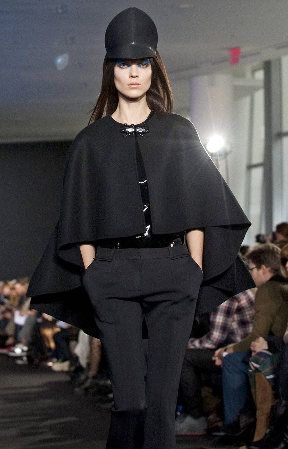 There was a lot to love about Nepalese-born designer Prabal Gurung's collection, which began with a high-impact grouping of black-on-black looks. This fitted and flared pant reappeared frequently and established an elongated silhouette. As for the visor, you'd take orders from someone wearing that, wouldn't you?