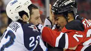 New Jersey Devils' Mark Fraser, right, fights with Winnipeg Jets' Chris Thorburn during the first period of an NHL hockey game, Saturday, Nov. 5, 2011, in Newark, N.J. (AP Photo/Bill Kostroun)