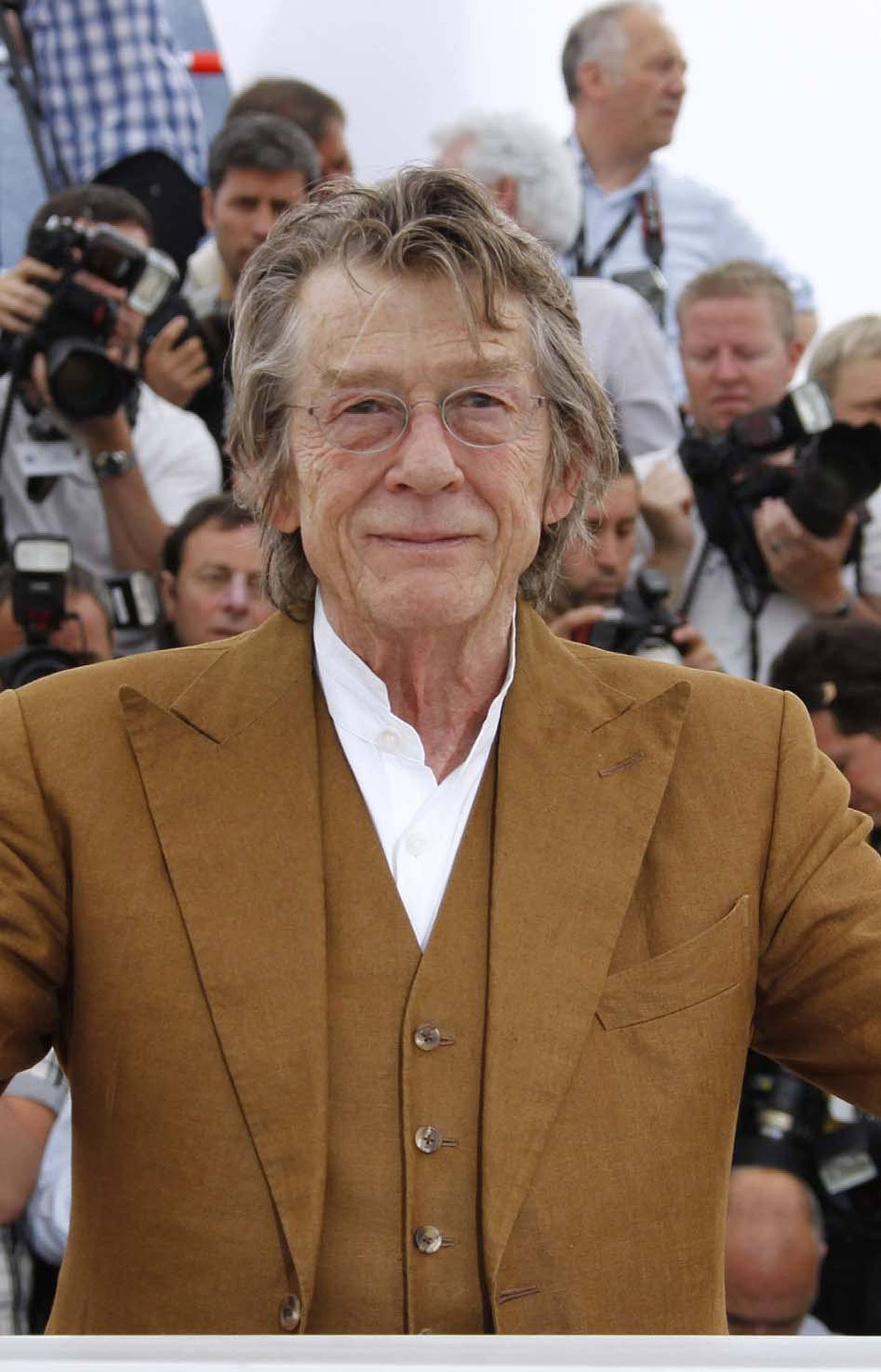 """Dapper British actor John Hurt at the photo call for """"Melancholia"""" at the Cannes Film Festival on Wednesday."""