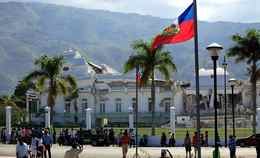 People walk in front of the badly damaged presidential palace of Haiti after a major earthquake hit Port-au-Prince