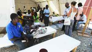 "Patients stricken with cholera are treated at ""Medecins Sans Frontieres"" facility in the Cite Soleil slum of Port-au-Prince on November 10, 2010. Aid groups fought to halt the spread of cholera in Haiti's teeming capital, where makeshift camps crammed with earthquake survivors are ripe ground for the epidemic to take hold."