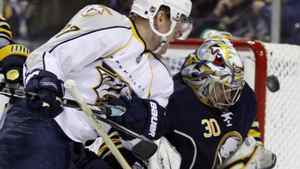 Buffalo Sabres goalie Ryan Miller makes a save on a shot by Nashville Predators' Patric Hornqvist (27), of Sweden, during the second period of an NHL hockey game in Buffalo, N.Y., Sunday, March 20, 2011. The Sabres lost 4-3 in OT. (AP Photo/David Duprey)