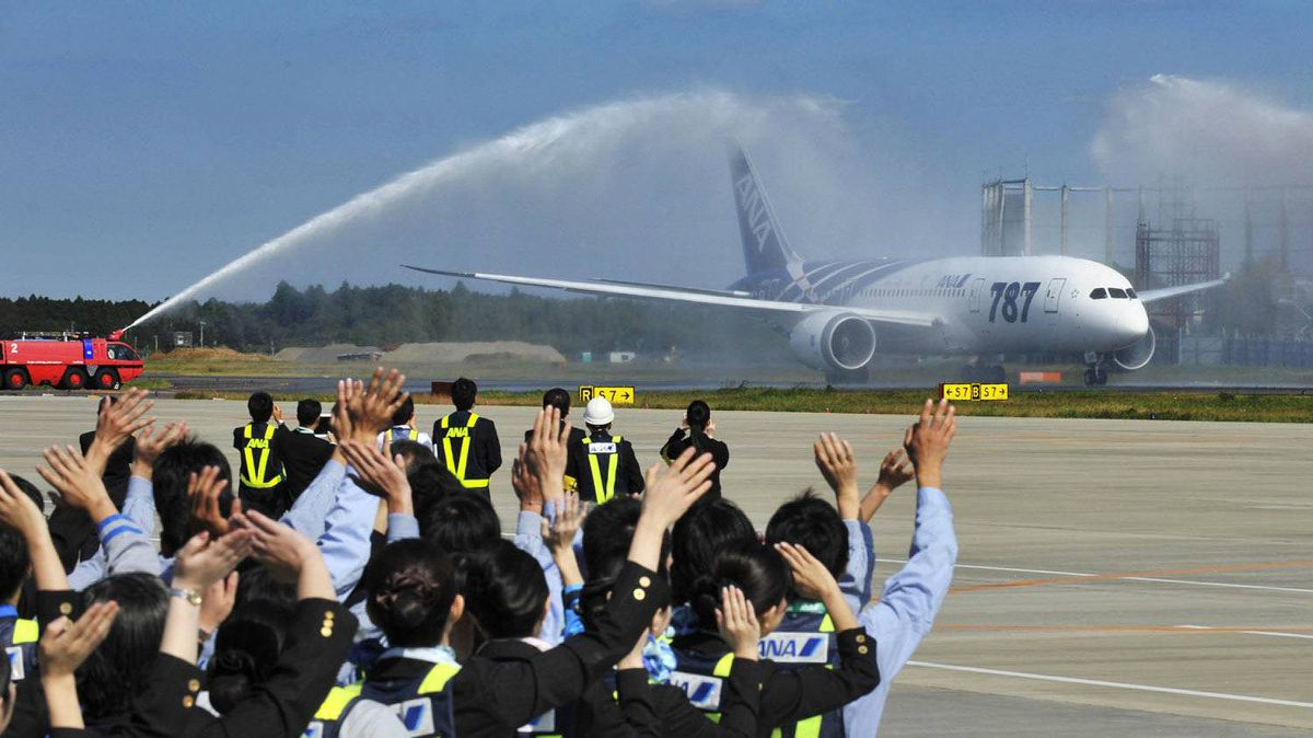 All Nippon Airways (ANA) ground crew see off the company's first commercial flight of a Boeing 787 Dreamliner at Narita Airport in Tokyo on Wednesday, Oct. 26, 2011. Passengers and airport staff treated the craft like a rock star, clapping at lift-off and landing.
