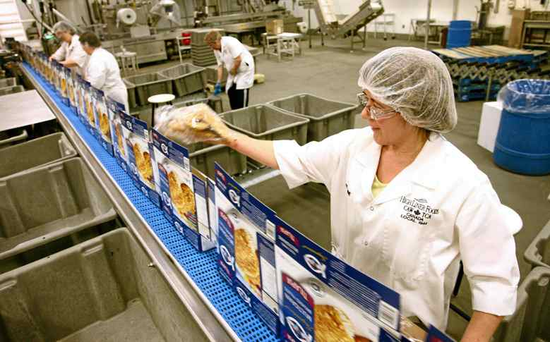 Workers run the assembly line package fish fillets at the High Liner Foods plant in Lunenburg, NS, March 10, 2010.