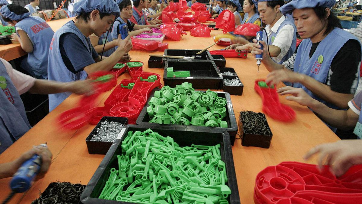 Labourers work toy factory in China's Guangdong province, in this file photo. China, until recently, had made strides in narrowing its current-account surplus. But now a wider Chinese trade surplus, and a U.S. trade deficit that grew 14 per cent in March, are replicating the imbalanced global economy that was too weak to withstand the ripple effects of the U.S. subprime-mortgage collapse.