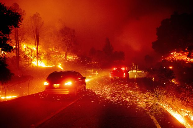 Millions face power cuts as California fires spread