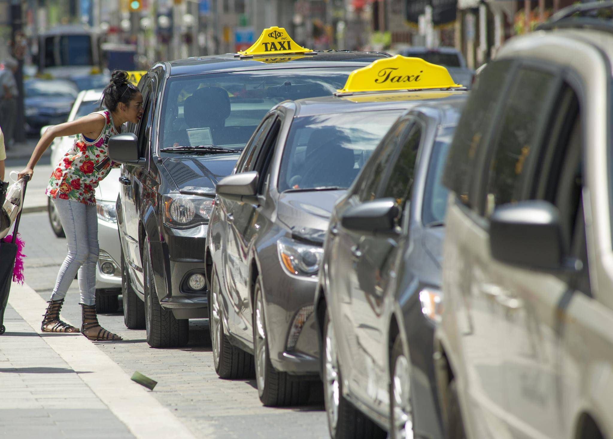 Competition bureau urges relaxed taxi rules to level playing field