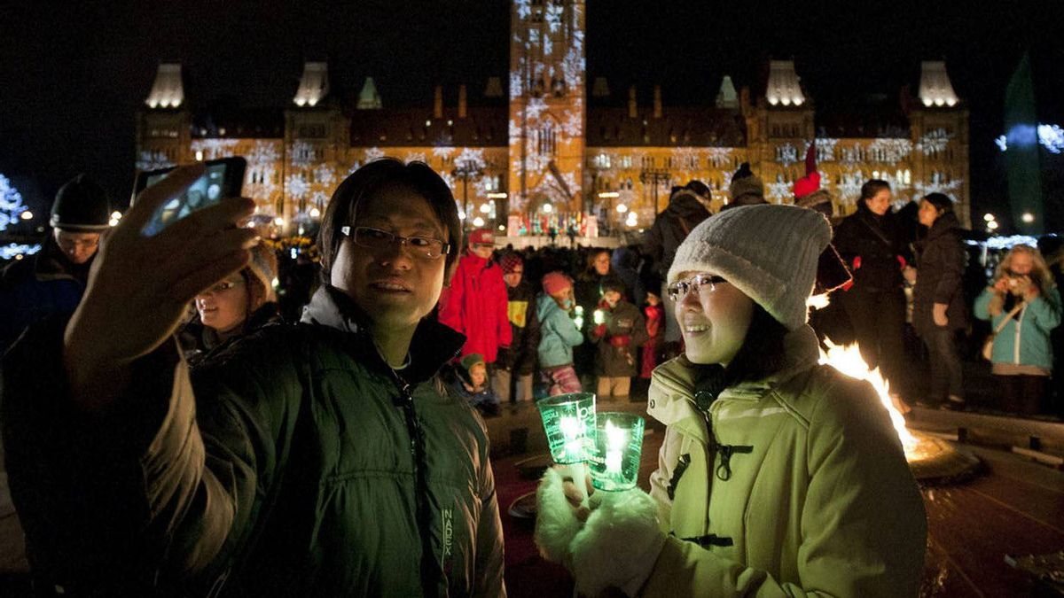 Tourists take a self-portrait in front of the Parliament buildings after they were lit up for Christmas on Dec. 1, 2011.