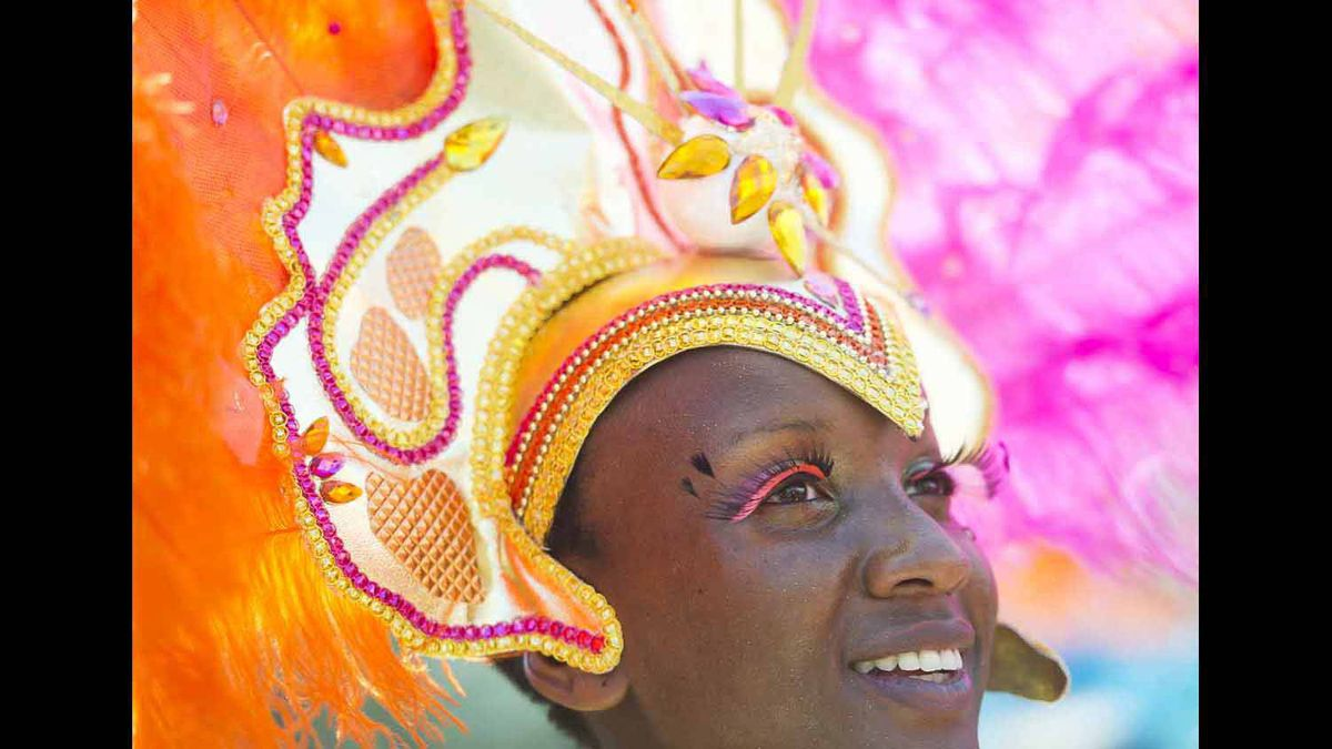 A dancer smiles at the Caribbean Carnival.