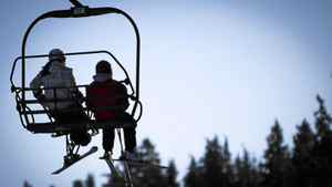 Chelaine McInroy, left, a 17-year-old born with spina bifida, makes her way up the chair lift at Whistler, B.C., on Dec. 11, 2011.