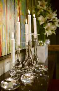 FLICKERING FLAMES No fireplace? No problem. Even if you don't have a functioning fireplace, you can create the same effect by assembling a collection of candlesticks on a sideboard, buffet or console. The candlesticks don't need to match, so pull out your tapers and tea lights and strike a match.
