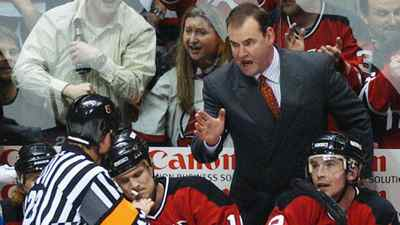 Coach Pat Burns talks to referee Brad Watson, left, during his tenure as coach of the New Jersey Devils in April, 2004.