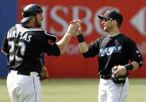 Toronto Blue Jays catcher Rod Barajas, left, and shortstop Marco Scutaro celebrate their win against the Baltimore Orioles.