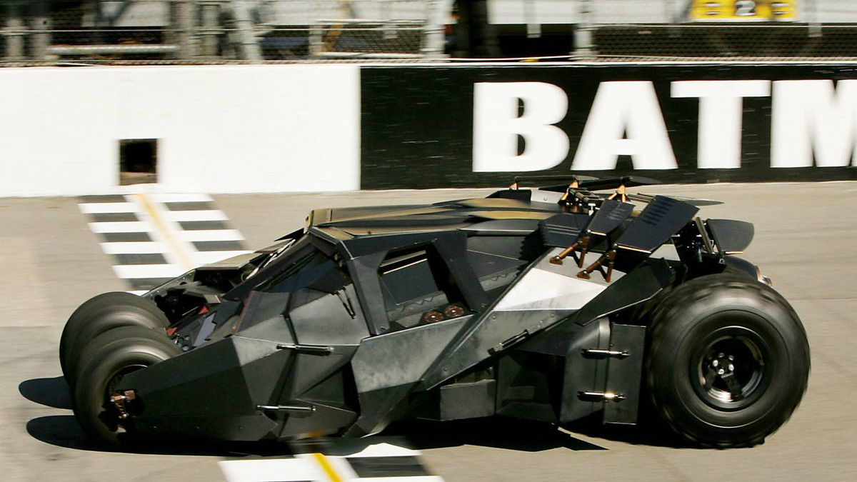 The Batmobile crosses the finish line at Michigan International Speedway, Friday, June 17, 2005, in Brooklyn, Mich. The photo opportunity promoted the movie and Sunday's Batman Begins 400 race.