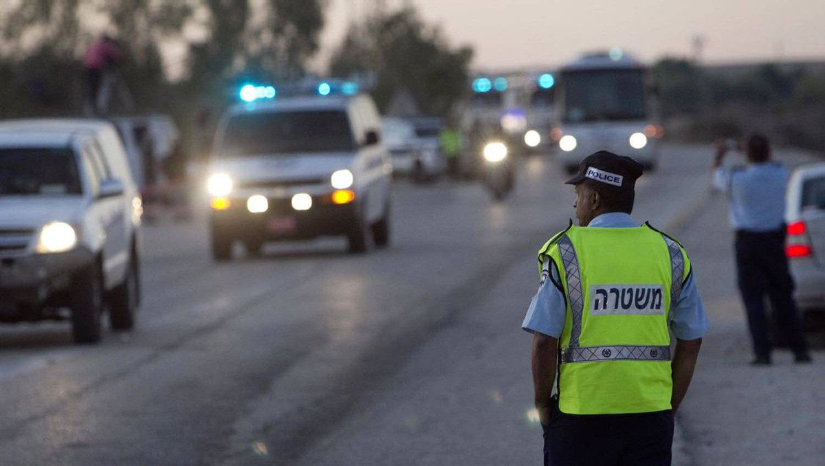 An Israeli policeman stands guard as a convoy carrying Palestinian prisoners leaves the Ketziot prison in southern Israel.