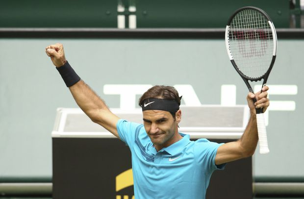 Federer survives scare against Paire to extend grass-court win streak to 18