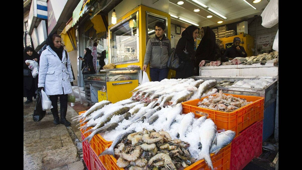 Customers shop at a food store in Tehran January 6, 2012.