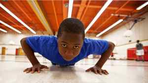 Tad Pfupa, 13, demonstrates exercises he does in the physical education ACE program at Camilla Road Senior Public School in Mississauga on May 16, 2012. Before he started the program, he could only do 30 pushups and now he can do 70 pushups.
