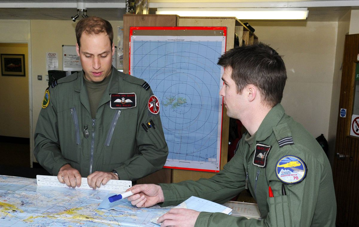 Prince William, left, prepares for his first sortie with a crew member at Mount Pleasant Complex in the Falkland Islands, on Feb. 4, 2012.