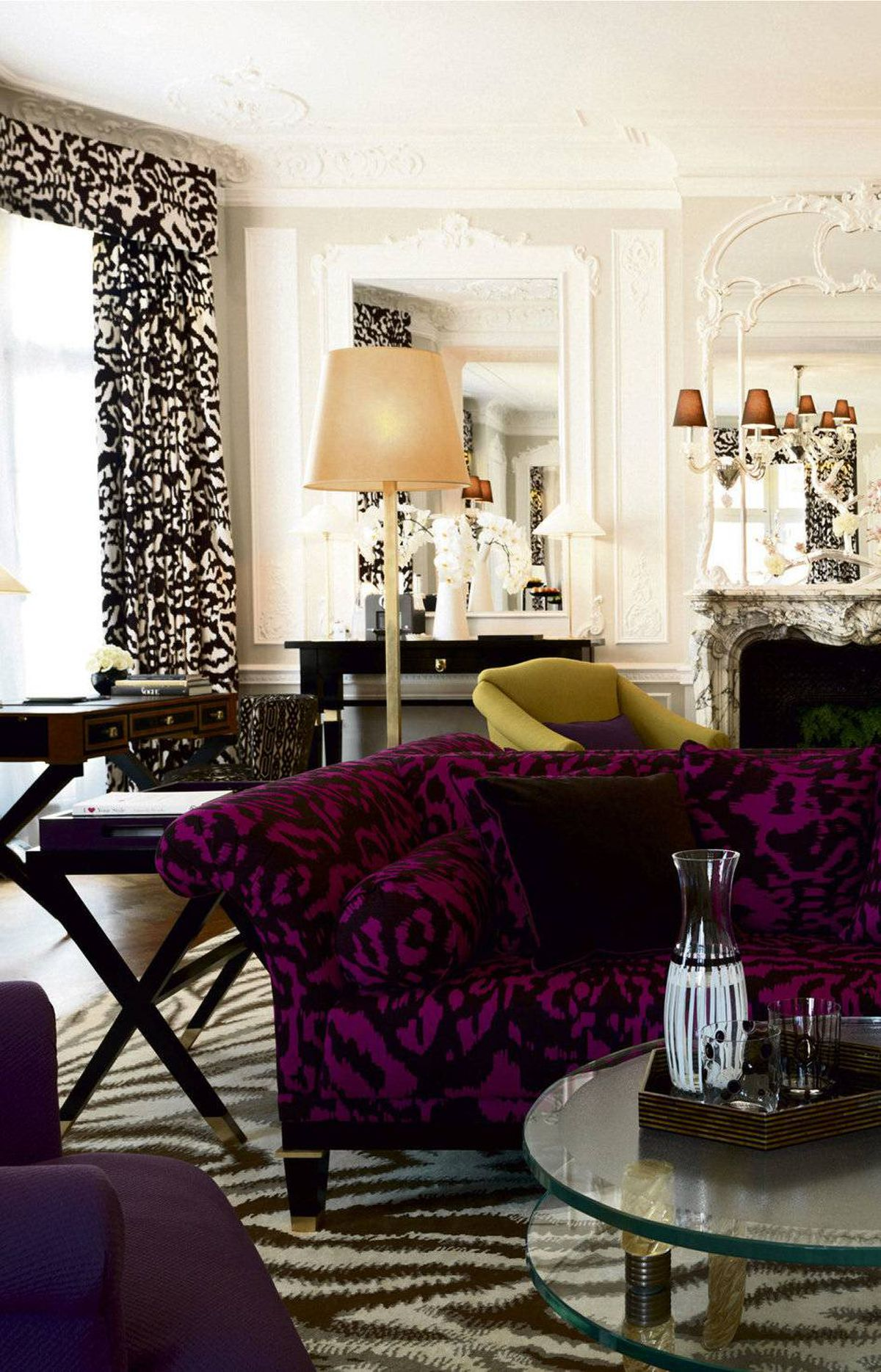 CLASHING PATTERNS Witness this suite design for Claridge's, the London hotel, by fashion's Diane von Furstenberg: Although the sofa, drapes and carpet sport varying screaming patterns, all are black in tone and only one has an attention-grabbing (purple) base. Visit www.claridges.co.uk for further inspiration.