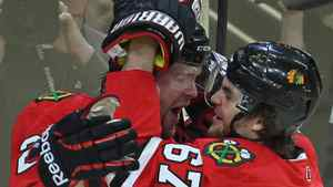 Michael Frolik #67 of the Chicago Blackhawks hugs teammate Bryan Bickell #29 after Bickells' 1st period goal against the Vancouver Canucks. (Photo by Jonathan Daniel/Getty Images)