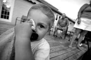 """August 22/09 - Grandson Colby Pellerine rubs his eye with his blanket while his grandparents Fielding Smith, a former employee of Trentonworks Railcar Plant in Trenton, Nova Scotia, Canada, and Robby Smith look on at their home in Springville. The company went bankrupt leaving the employee pension underfunded by as much as 30% as well as loosing their health benefits. The couple call their grandson the """"shine of their lives"""" and can no longer buy him all the things they used to buy. Photo By Deborah Baic The Globe and Mail"""