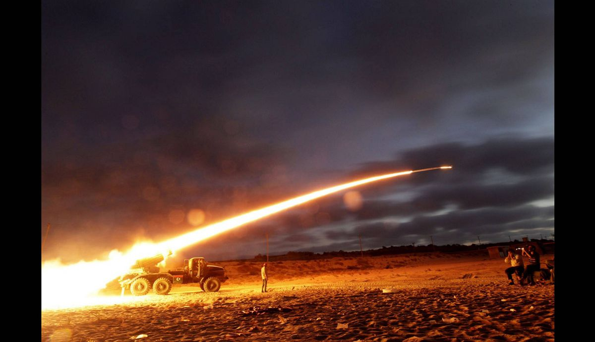 Rebel fighters fire a Grad rocket at the front line west of Misrata, Libya, June 20, 2011.