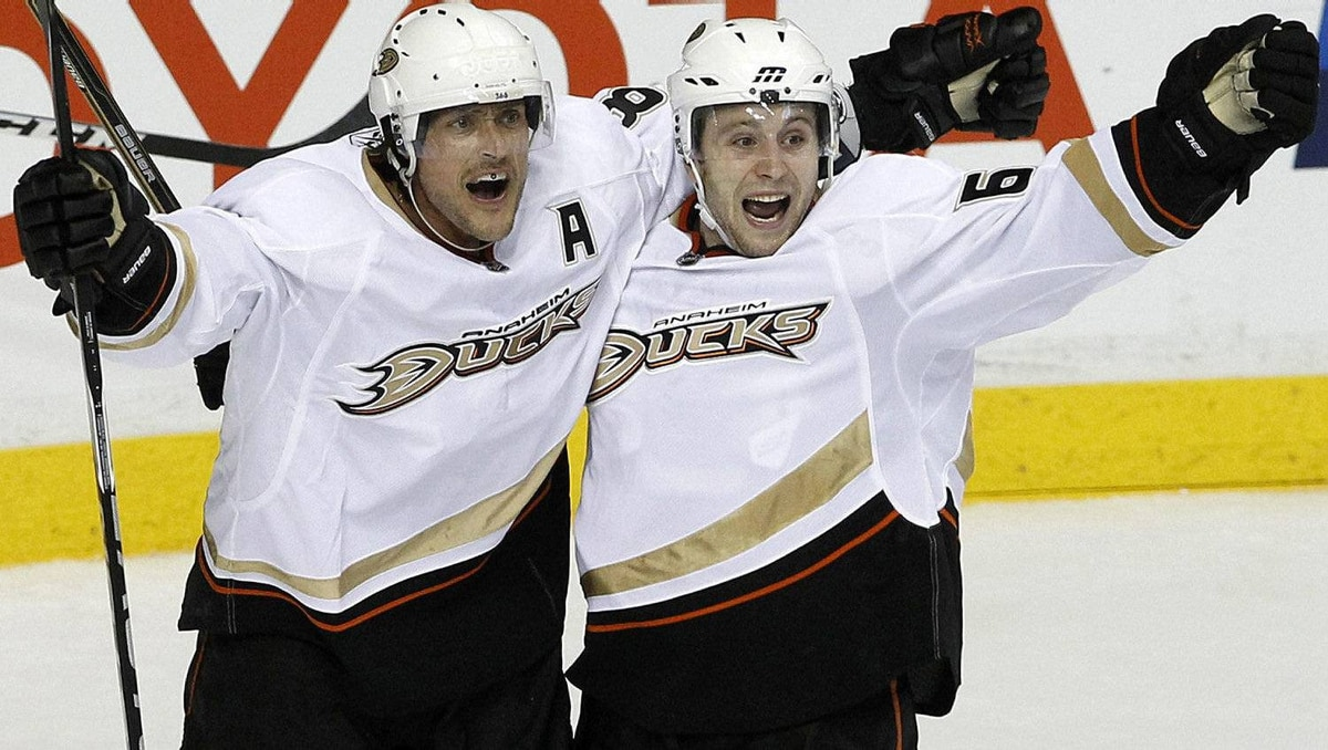 Anaheim Ducks right wing Teemu Selanne, left, of Finland, celebrates with Brandon McMillan in the second period after Selanne scored his second goal of the game. (AP Photo/Mark Humphrey)