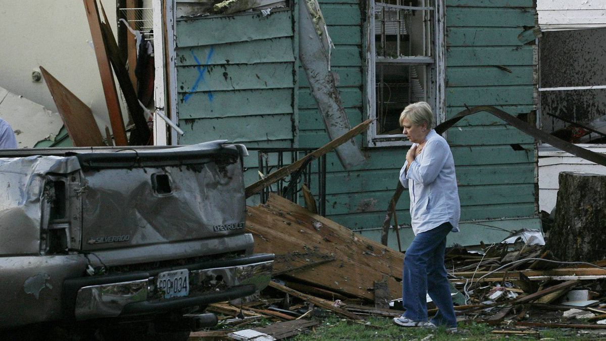 Evelyn Knoblauch surveys the damage to her children's home after it was destroyed when a tornado hit Joplin, Missouri May 23, 2011.