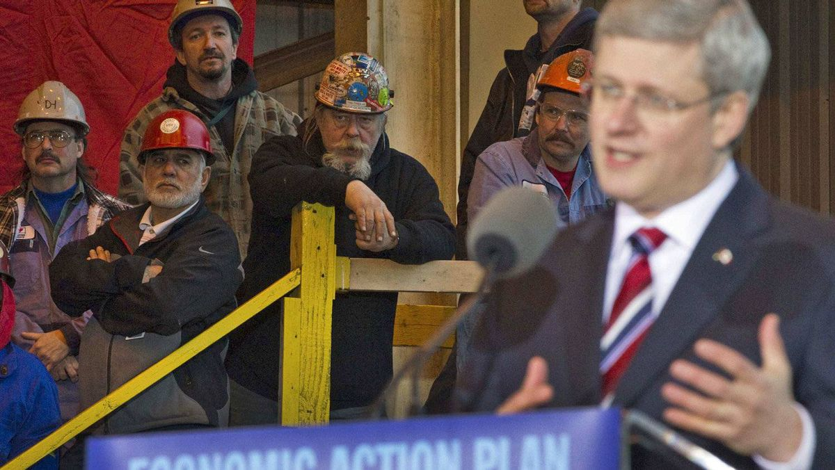 Workers listen as Prime Minister Stephen Harper details the completion of the government's deal with Seaspan shipyards to to build non-combat Coast Guard and Royal Canadian Navy vessels in North Vancouver on Jan. 12, 2012.