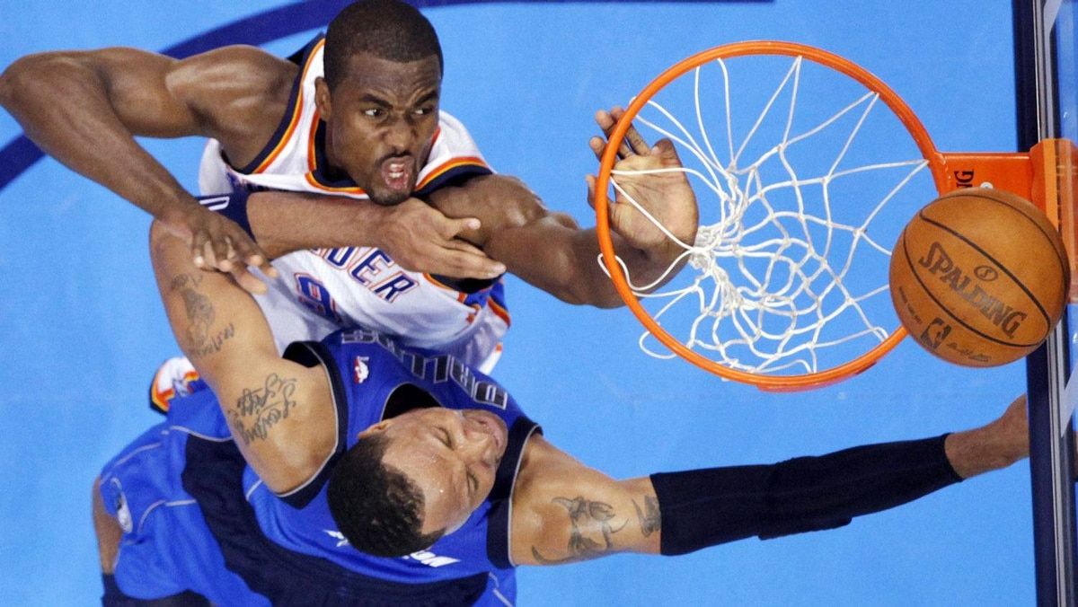 Oklahoma City Thunder's Serge Ibaka (top) contests a shot by Dallas Mavericks' Shawn Marion during the first half of Game 1 of their NBA Western Conference quarter-final playoff series in Oklahoma City April 28, 2012. REUTERS/Steve Sisney