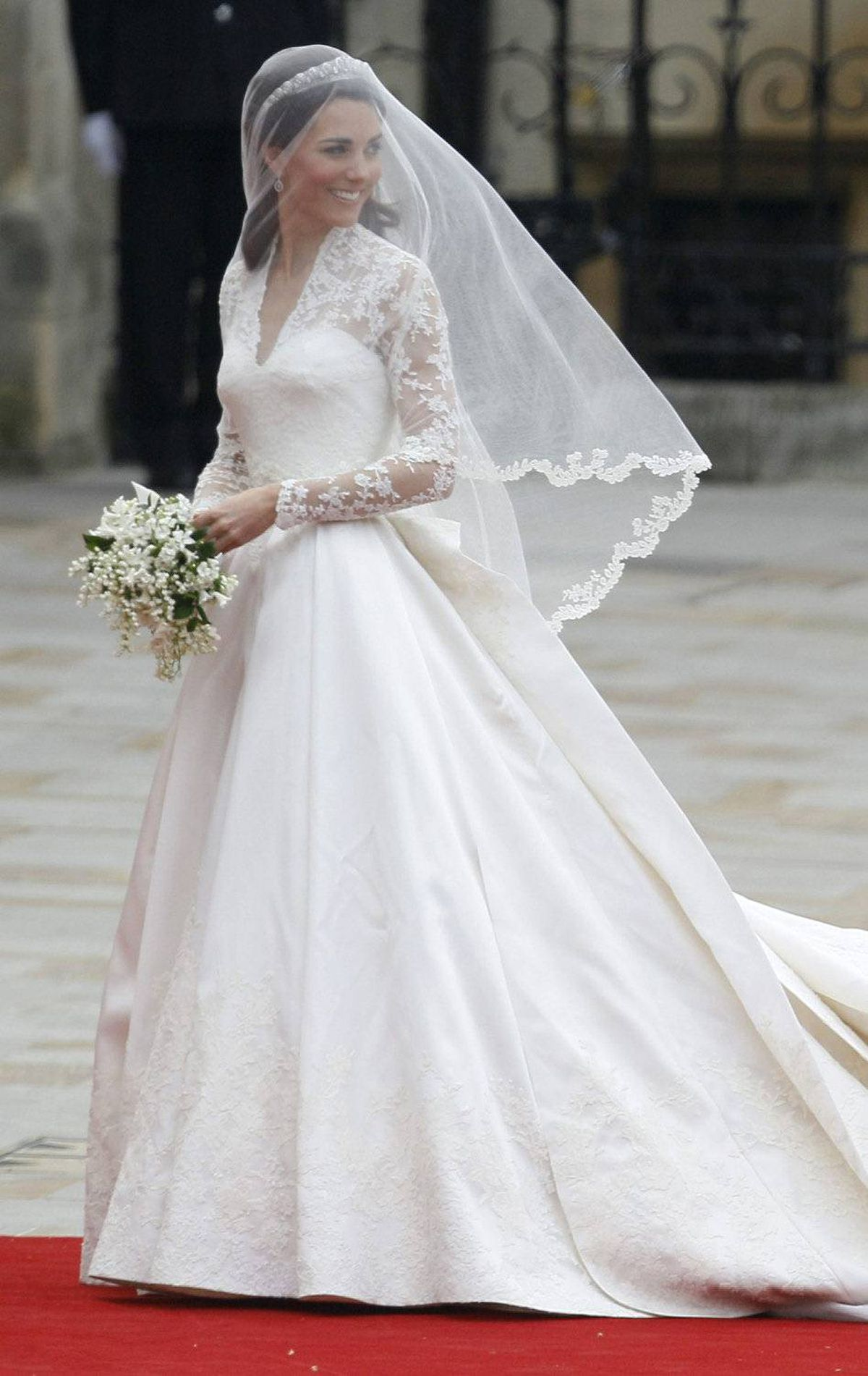 The dress that starts it all: Kate Middleton arrives for her April 29 wedding at Westminster Abbey in a gown by Sarah Burton for Alexander McQueen.