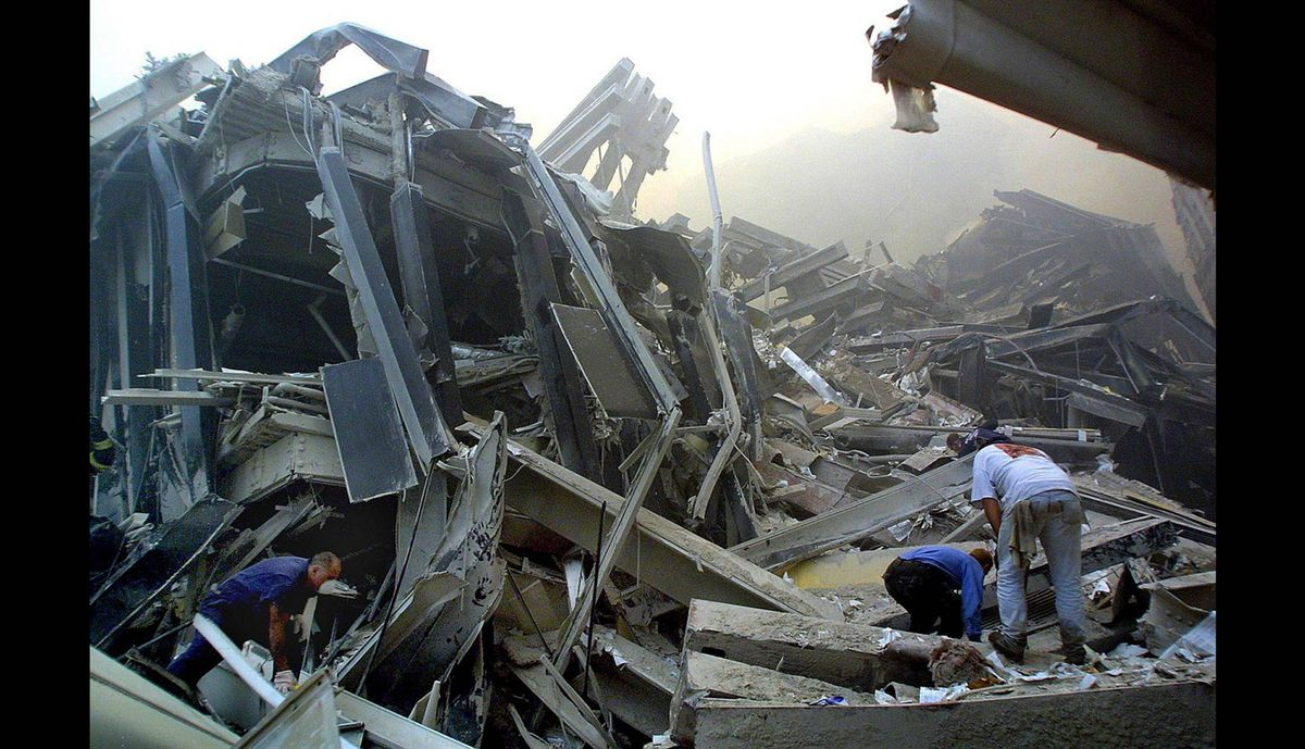 Rescue workers make their way through the rubble of the World Trade Center on Sept. 11, 2001 in New York after two hijacked planes flew into the landmark skyscrapers.